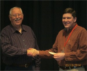 John Meyer (left) presents check to Dave Heupel