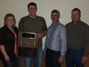 Eason Feedlot took home the traveling award for support of the Greene County Cattlemen's Association. Pictured are (from left) Amanda and Brent Schroeder of Easton Feedlot, Cattlemen president Mick Towers, and Curt Eason.