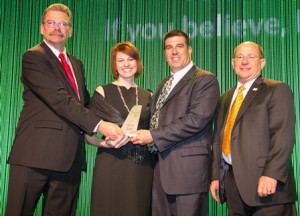 Jim Call (left), chairman of the United Soybean Board presents David Ausberger the Conservation Legacy Award. Also pictured is LeeAnna Ausberger and American Soybean Association president Ray Gaesser (right). Photo by Sandra Martin | American Soybean Association