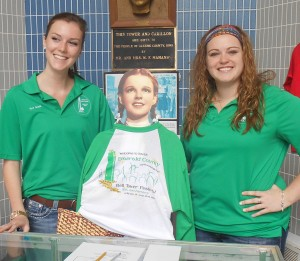 Dorothy Gale of Kansas models this year's Bell Tower Festival T-shirt at the Mahanay Bell Tower. With her are Bell Tower guides Hannah Ober (left) and Maggie Feldmann.