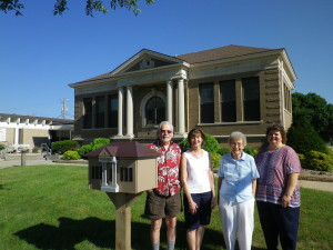 With the Little Free Library are (from left) Jim Rose, Barb Labate, Joyce Turner and Jane Millard