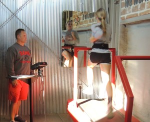 Jeff Schroeder takes Carleigh Paup through a workout on the PXP treadmill