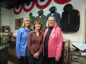 Janet Durlam, Dianne Piepel and Denise O'Brien Van in front of a World War Two display at the museum