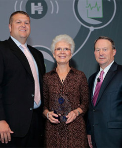 Greene County Medical Center CEO Carl Behne, Laine Custer, IHA board chair John Townsend