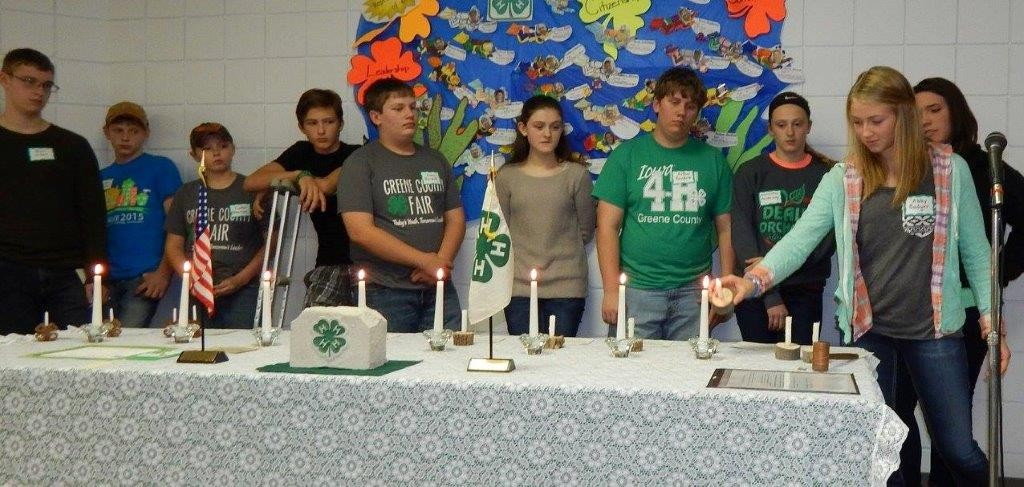 Pictured at the Greenbrier 4-H Club officer installation are (from left) Mani Jubell, Caedon Messer, Caden Etherton, Brian Hardaway, Avery Bardole, Josey Weaver, Arthur Bardole, Samantha Hardaway and Kara Schroeder with Abby Badger starting the installation process by lighting her candle.