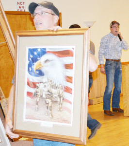 Auctioneer Terry Laughery assisted his nephew, the fourth generation of Laughery Auctioneers, with the live auction of items during the Greene County Pheasants Forever banquet. In the background is Clay Stetzel who cried the sale. | Scranton Journal photo