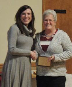 Lori Smith (right) accepts a plaque noting 25 years of membership for Ben Franklin from Chamber president Omega Sang (left)