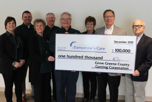 """Grow Greene County Gaming Corp board member representatives (from left) Lori Mannel, Bob Allen, Kate Neese, Mike Mumma, Norm Fandel and Peg Raney present their gift to """"Investing in Tomorrow's Care"""" capital campaign co-chairs John Gerken and Rick Morain."""