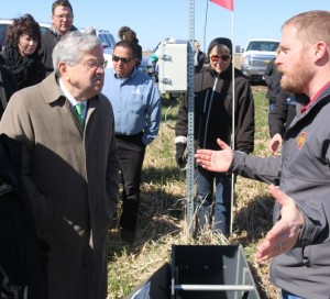 Iowa Governor Terry Branstad, left, was briefed on the details of the Greene County bioreactor by Keegan Kult, right, environmental scientist with the Iowa Soybean Association. ~photo by The Perry News