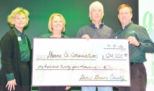 Greene County conservation director Dan Towers (second from right) collected the check from (from left) Kate Neese, Brenda Muir and Craig Marquardt.