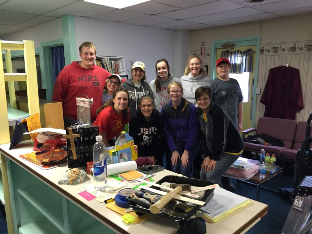 The painting crew included (front, from left) Kelsey Buenz, Emily Heupel, Victoria Peterson and Wendy Pittman; and (back, from left) Wade Wuebker, Lakota Larson, Alison Gallagher, Hannah Stein, Hannah Peterson and Chance Peterson.