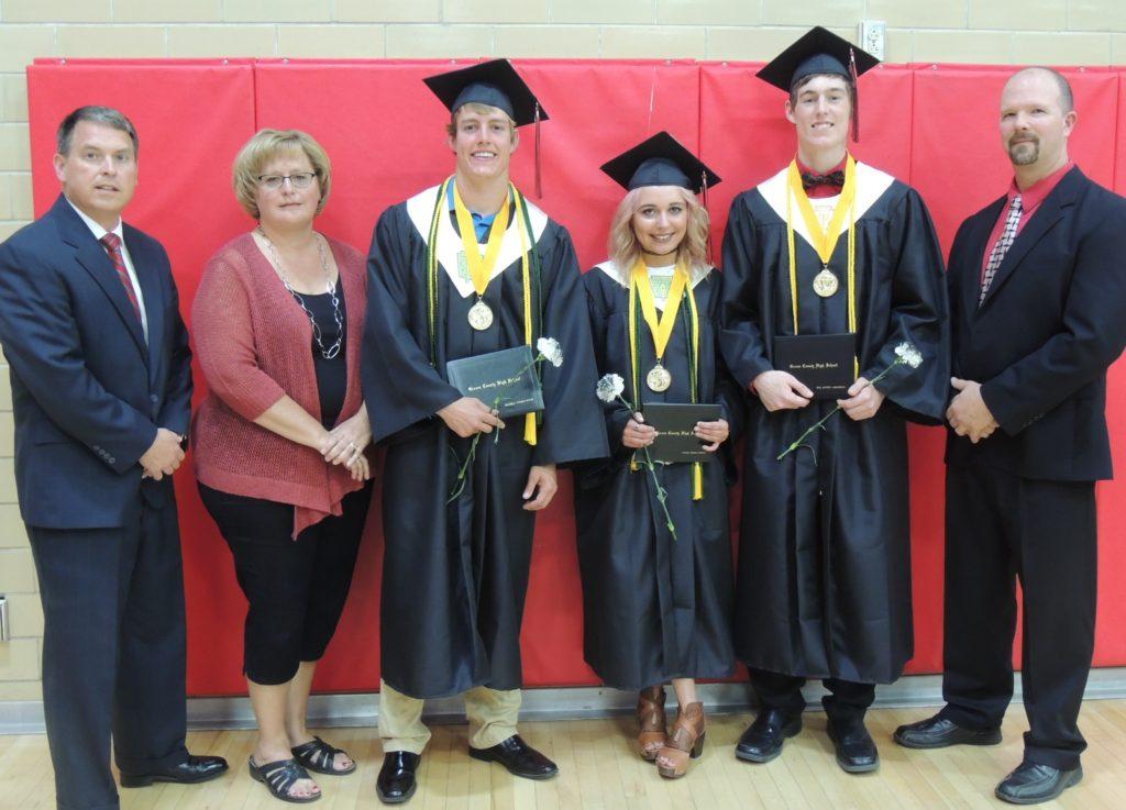 (from left) superintendent Tim Christensen, school board president Teresa Hagen, Max Neese, Lakota Larson, Reid Lamoureux, principal Brian Phillips