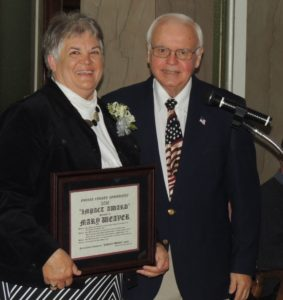 Impact Award recipient Mary Weaver and presenter Jerry Roberts