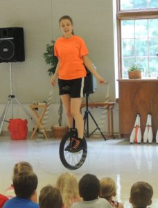Christa jumps rope on a unicycle