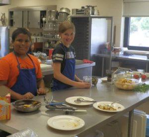 Corbin Blair left) and Natalie Heupel in the kitchen