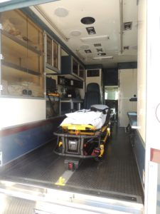 A rolling hospital room with space for six EMTs and a patient