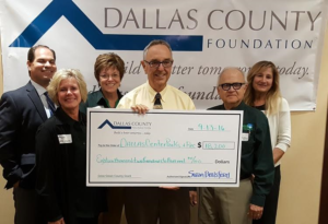 Pictured are (from left) Dallas County Foundation treasurer Tim Canney, Kate Neese and Peg Raney of Grow Greene County, Bob King accepting the check, Rick Morain of Grow Greene County, and Dallas County Foundation president Susan Brelsford. | photo by The Perry News