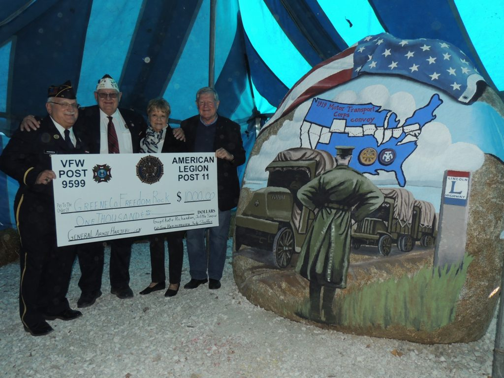 (from left) American Legion post commander Jim Andrew, VFW post commander Don Ihnken, and Katie and Guy Richardson