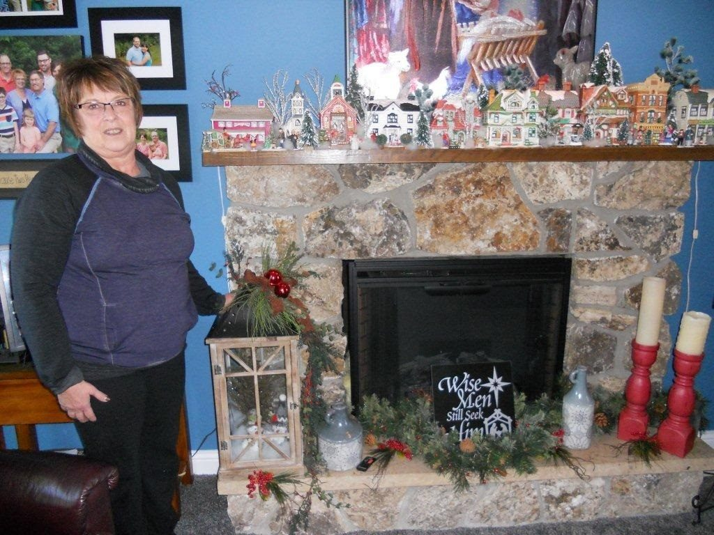 Darla Johnson displays her Christmas village collection on her mantle.