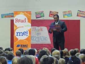 News anchor Marcus McIntosh reads to students